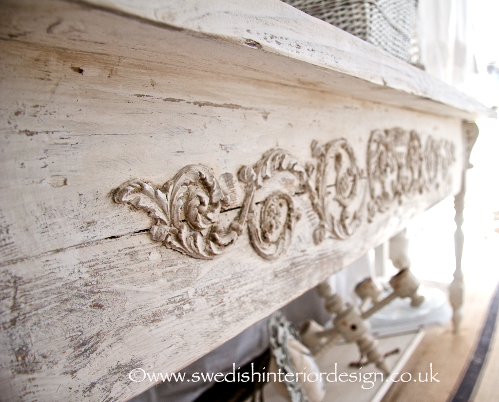 gustavian carving on a bespoke table from swedishinteriordesign.co.uk