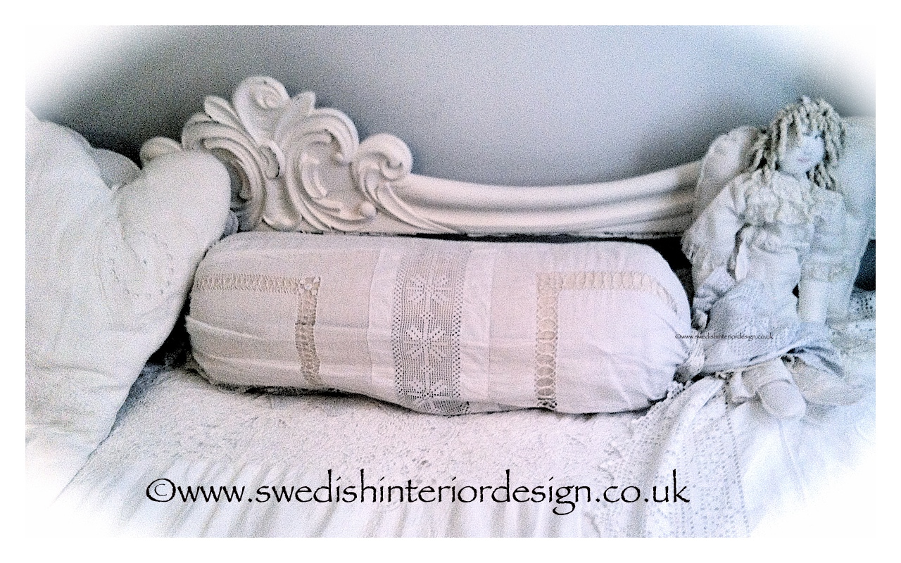 bespoke bolster with antique lace cover
