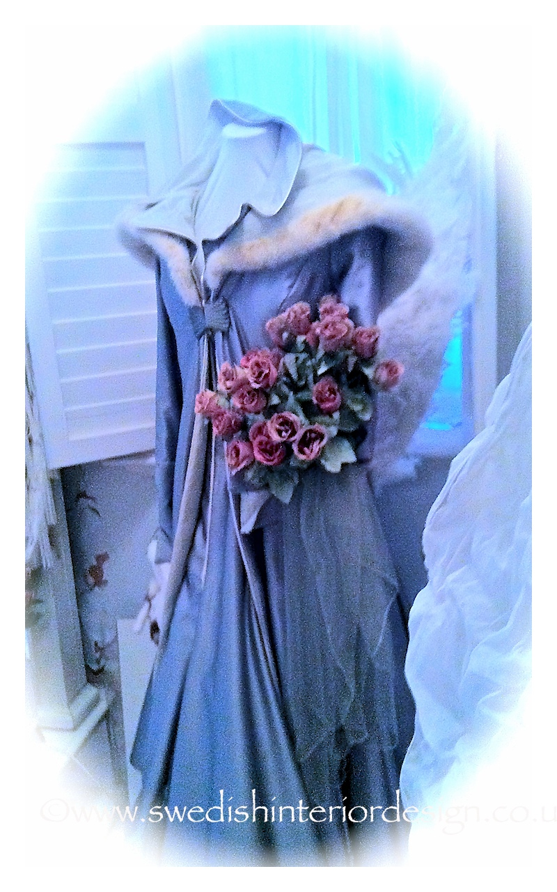handmade bespoke wedding dress with hand stitched silk and ermine