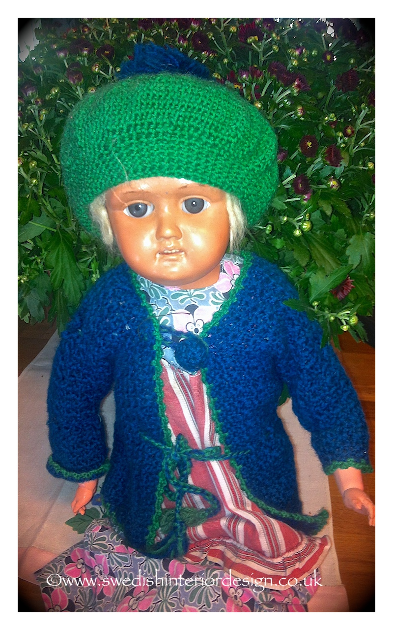 green cap antique doll from sweden