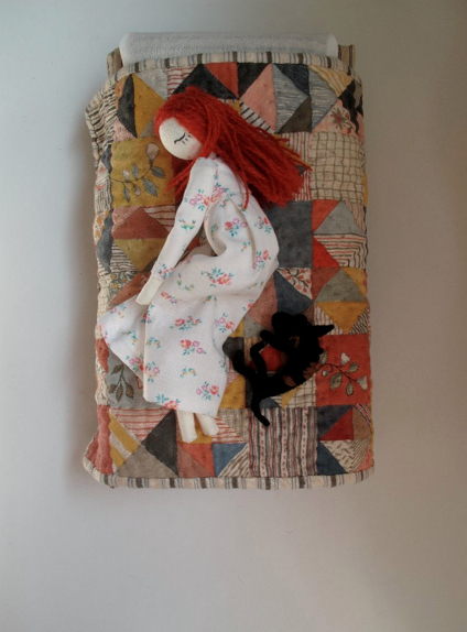 doll on quilt
