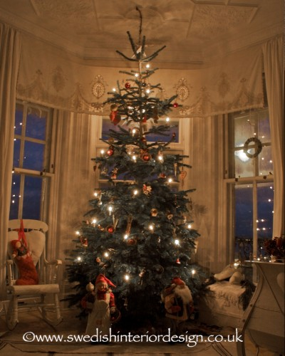 swedish christmas tree with antique decorations