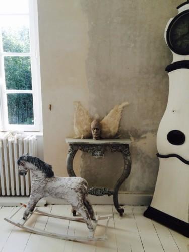 antique Mora clock and antique rocking horse
